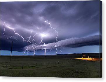 Lightning Strikes Canvas Print by Roger Hill