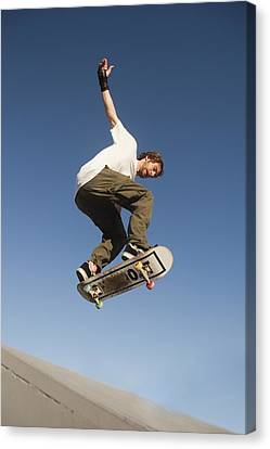 Low Angle View Of Young Male Canvas Print by Marcos Welsh