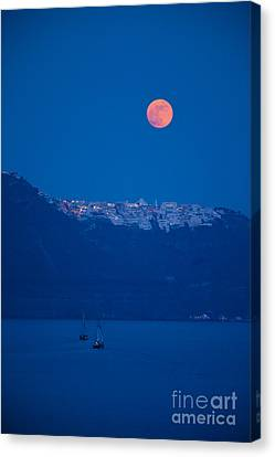 Moon Over Santorini Canvas Print by Brian Jannsen