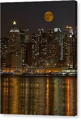 Moonrise Over Manhattan Canvas Print by Susan Candelario
