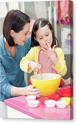Tasting Canvas Print - Mother And Daughter Baking by Ian Hooton