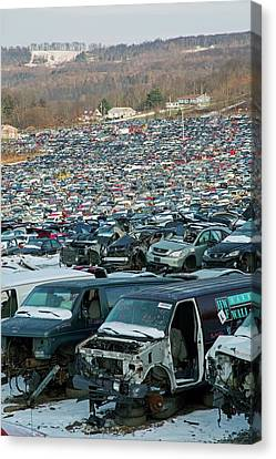 Motor Vehicles At A Scrapyard Canvas Print by Jim West