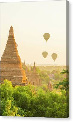Myanmar Bagan Hot Air Balloons Rising Canvas Print by Inger Hogstrom