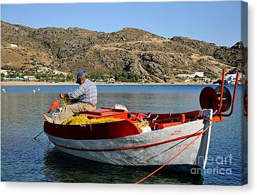 Fisherman In Mylopotas Beach Canvas Print