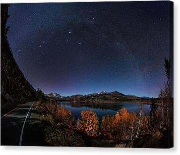 Night Sky Over June Lake Canvas Print by Babak Tafreshi