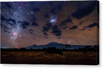 Night Sky Over Mount Kilimanjaro Canvas Print by Babak Tafreshi