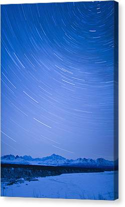 Night Time View Of Star Trails Over Mt Canvas Print by Kevin Smith