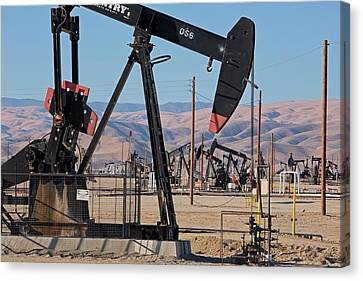 Oil Production Canvas Print by Jim West