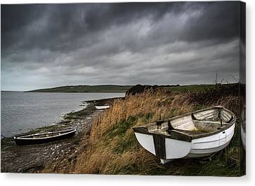 Old Decayed Rowing Boats On Shore Of Lake With Stormy Sky Overhe Canvas Print by Matthew Gibson