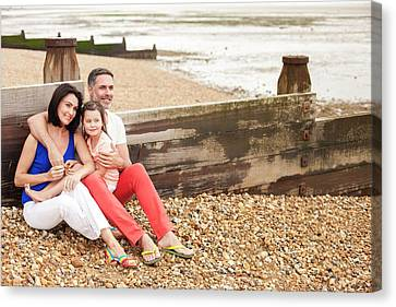 Bonding Canvas Print - Parents On Beach With Daughter by Ian Hooton