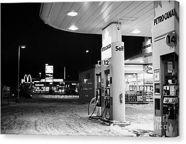 petro canada winter gas fuel pump at service station Regina Saskatchewan Canada Canvas Print by Joe Fox