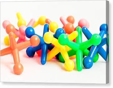 Selection Canvas Print - Plastic Toys by Tom Gowanlock