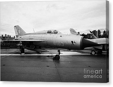 Polish Air Force Mig 21 Pfm On Display On The Flight Deck At The Intrepid Sea Air Space Museum Canvas Print by Joe Fox