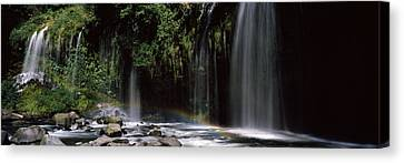 Rainbow Formed In Front Of Waterfall Canvas Print