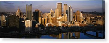 Reflection Of Buildings In A River Canvas Print by Panoramic Images