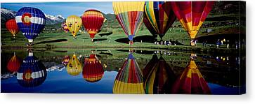Activity Canvas Print - Reflection Of Hot Air Balloons by Panoramic Images
