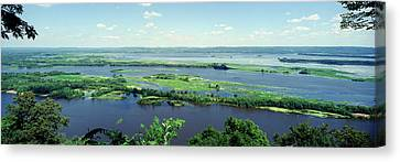 River Flowing Through A Landscape Canvas Print by Panoramic Images