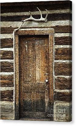 Rustic Cabin Door Canvas Print by John Stephens