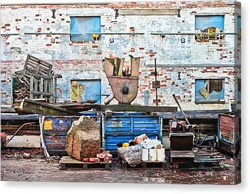 Scrap Yard Canvas Print by Tom Gowanlock