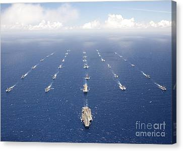 Ships And Submarines Participating Canvas Print by Stocktrek Images