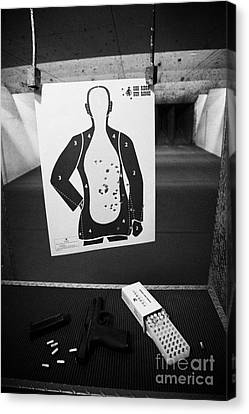 Smith And Wesson 9mm Handgun With Ammunition At A Gun Range In Florida Usa Canvas Print by Joe Fox