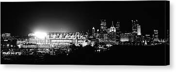 Stadium Lit Up At Night In A City Canvas Print by Panoramic Images
