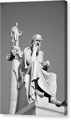 Statues Of Socrates And Apollo Canvas Print by George Atsametakis