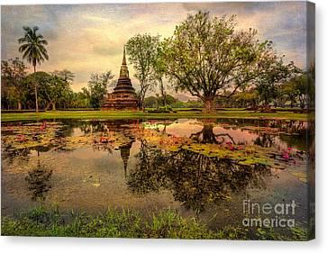 Sukhothai Historical Park Canvas Print by Adrian Evans