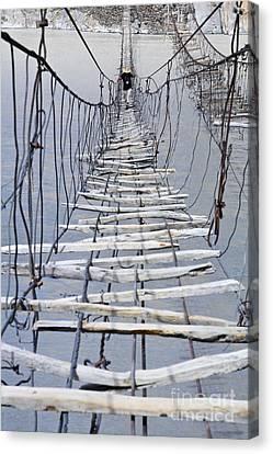 Suspension Bridge Across The Hunza River Canvas Print by Robert Preston