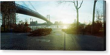 Suspension Bridge Over A River Canvas Print by Panoramic Images