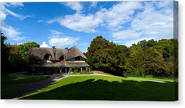 Swiss Canvas Print - Swiss Cottage Cottage Ornee On A Hill by Panoramic Images