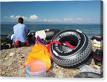 Inflatable Canvas Print - Syrian Refugees Arriving On Greek Island by Ashley Cooper