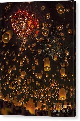 Thai People Floating Lamp Canvas Print by Anek Suwannaphoom