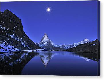 The Matterhorn And Riffelsee Lake Canvas Print by Thomas Marent