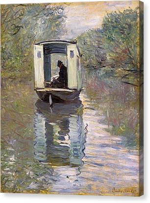 The Studio Boat Canvas Print by Claude Monet