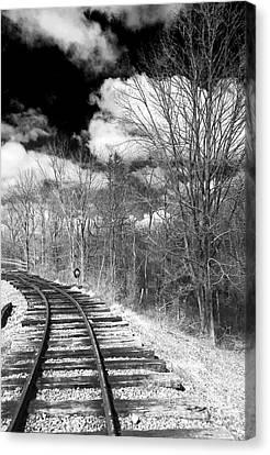 Tracks Canvas Print by John Rizzuto
