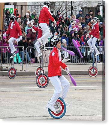 Unicyclists At A Parade Canvas Print