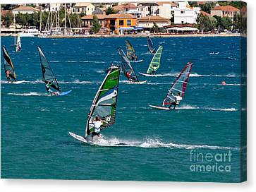 Windsurfing In Vasiliki Bay Canvas Print by George Atsametakis