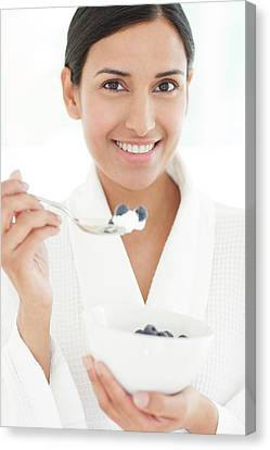 Woman Holding Bowl Of Fruit And Spoon Canvas Print