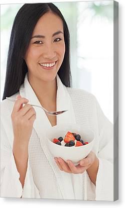 Chinese Ethnicity Canvas Print - Woman Holding Bowl Of Fruit by Ian Hooton