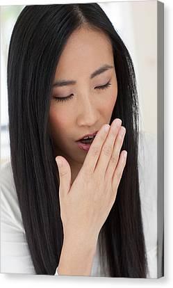 Woman Yawning Canvas Print by Ian Hooton
