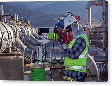 Worker Inspecting Water Pumps Canvas Print