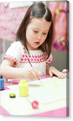Young Girl Painting Canvas Print