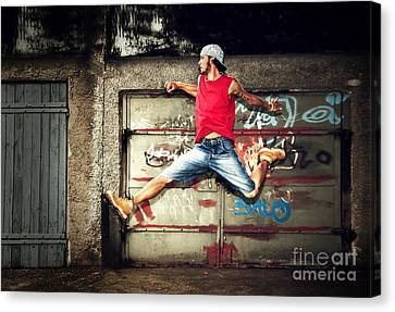 Young Man Jumping On Grunge Wall Canvas Print by Michal Bednarek