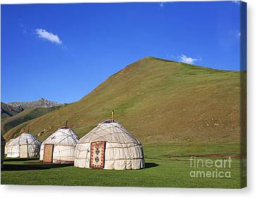 Yurts In The Tash Rabat Valley Of Kyrgyzstan  Canvas Print by Robert Preston
