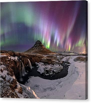 Snowy Night Canvas Print - Aurora Borealis by Babak Tafreshi