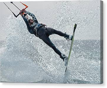 A Man Kitesurfing  Tarifa, Cadiz Canvas Print by Ben Welsh