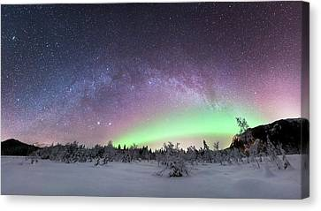 Aurora Borealis And Milky Way Canvas Print by Tommy Eliassen