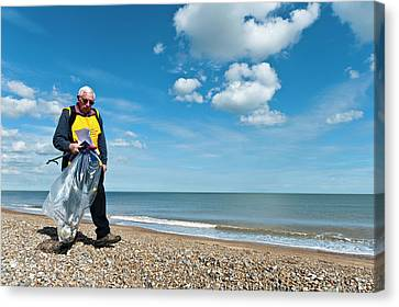 Beach Clean-up Canvas Print by Matthew Oldfield
