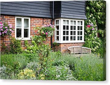 Cottage Garden Canvas Print by Tom Gowanlock